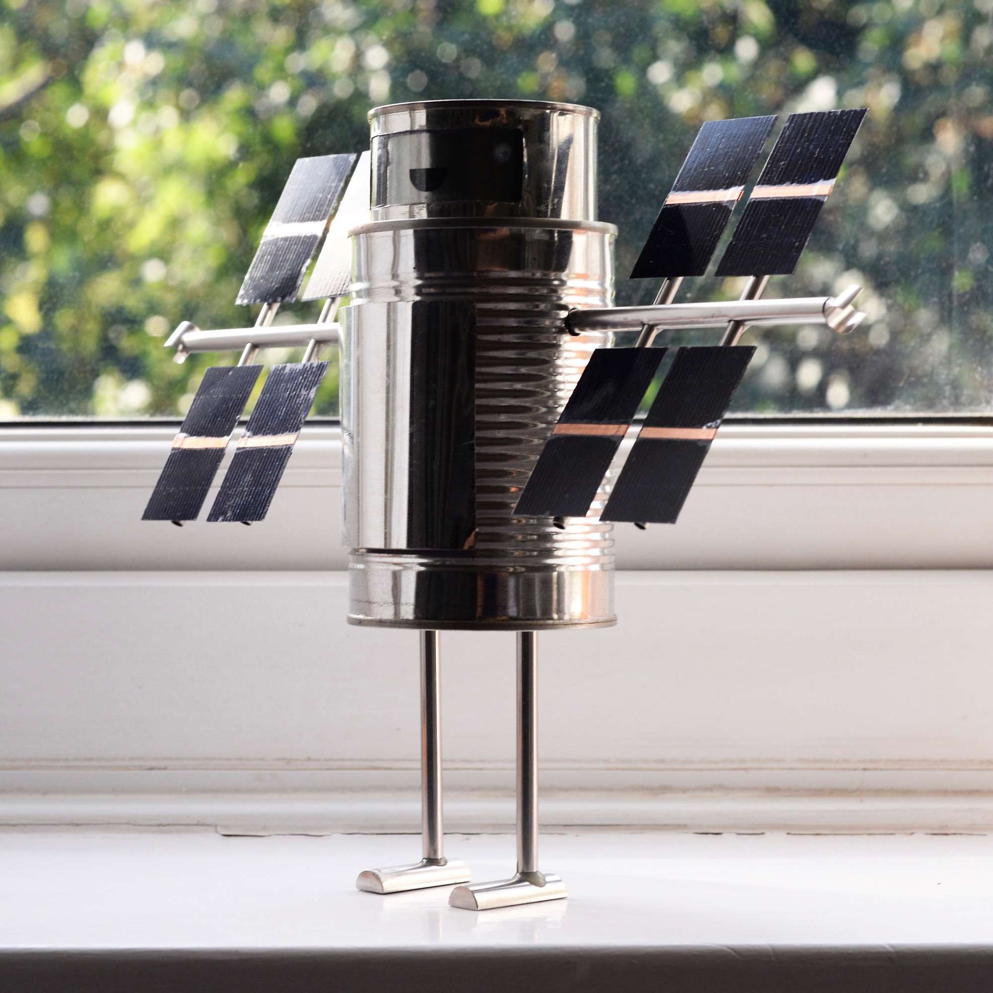 My solar robot, sitting on the windowsill, harvesting sunlite